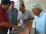 Pres. Malayang plays with the Interactive Screen while Macalolot, Agnir and Fontelo look on.