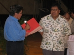 Dr. Renato Querubin, SUACONA chair, presents to Dr. Malayang SUACONA's 'Investiture Gift' certifying the amount raise