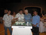 Architect Almagro and President Malayang looking at scale model of Portal West building with members of the Silliman adm