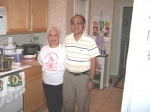 Ed and Ruby Agnir, hosts of the Oct 7 gathering pose in their kitchen